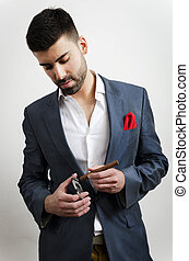 business - Businessman in a suit, smoking cigare