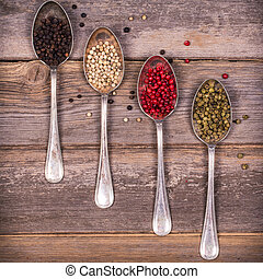 Peppercorns in silver spoons - Tarnished silver spoons...