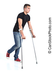 Man walking with crutches isolated on a white background...