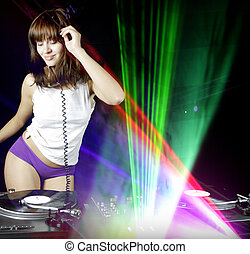 liva dancing - sex girl djing behind the turntables in a...