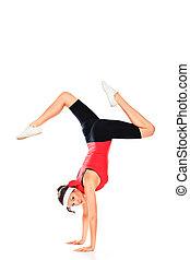 acrobatics - Slender sportive woman doing acrobatics....