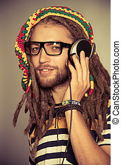 meloman - Portrait of a happy rastafarian young man...
