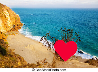 Heart on the top of hill next the ocean