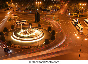 madrid traffic - rush of night time traffic on road in...