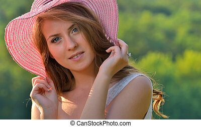 Portrait of pretty cheerful girl in nature
