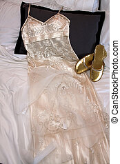 Wedding gown - Woman\\\'s white wedding dress laid out...
