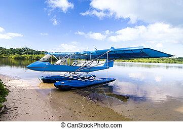 Pontoon Plane - A sightseeing pontoon airplane floating on...