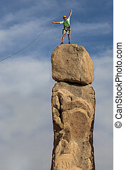 Successful climber at the top. - Male climber conquers the...