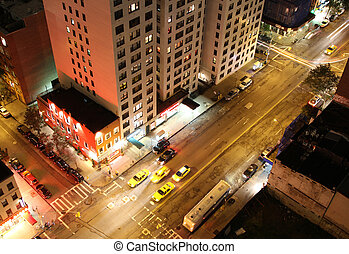 NYC street - looking down on night scene of a street in...
