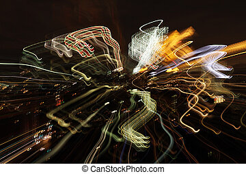 abstract lights - abstract light pattern made from city at...