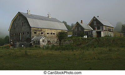 Farmyard in summer with barn, stable and farmhouse