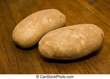 Two Potatoes on Wood Table