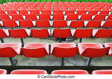 Red Bleacher Seats - Yellow bleacher seats in one of the...