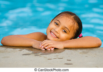 Portrait of mixed race girl in pool - Portrait of happy...