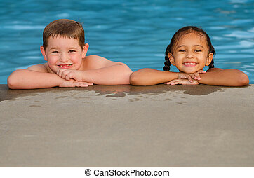 Children at pool side - Portrait of Caucasian boy and mixed...