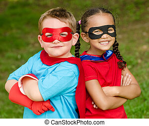 Kids pretending to be superheroes - Pretty mixed race girl...