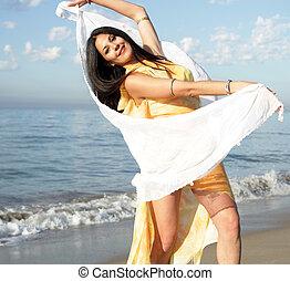 sonia beach - beautiful women dances on a beach at sunrise