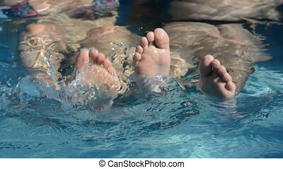 Feet splashing in the water - Womans and kids feet splashing...