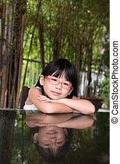 Little Asian girl - Portrait of little Asian girl with...