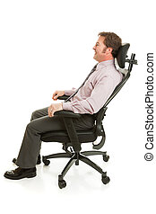 Relaxing in Ergonomic Chair - Businessman relaxing in a...