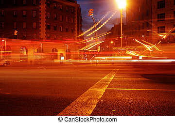 bcn traffic - rush of night time traffic on road in...