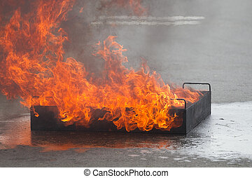 Fire burns in a training container - Big flame in container...