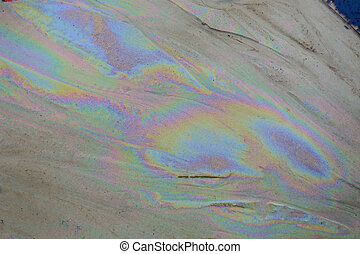 crude oil in sea water and rainbow reflection - crude oil in...
