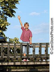 happy boy on wooden playground