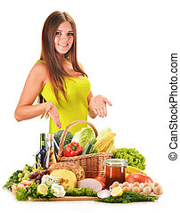 Young woman with assorted grocery products isolated on white...
