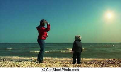 Mother teaching her son to throw