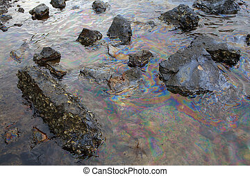 crude oil in sea water and rainbow reflection of crude oil...
