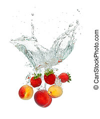 fresh fruit - Isolated shot of fruit falling into water,...
