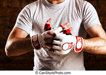 fighter - mma fighter is getting ready against brick wall