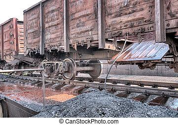 old railcar  - A long line of boxcars cleaned of debris