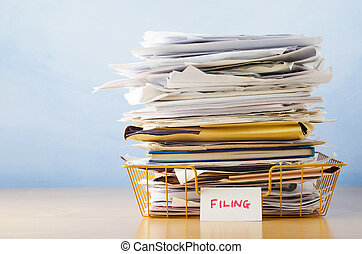 Filing Tray Piled High with Documents - An old yellow...