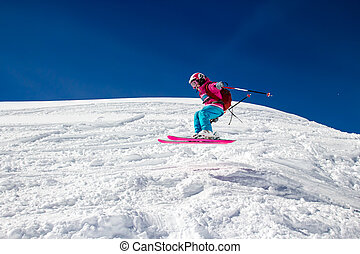 Little girl skier flies over the slope - Little girl with a...