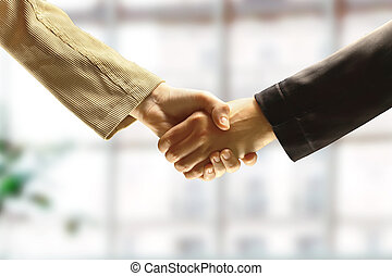 businessmans hand shaking white businessmans hand