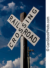 Railroad Crossing Sign - A railroad crossing sign against a...