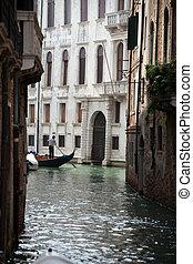 Narrow canal with gondolas in Venice, Italy