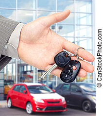 Hand giving a car key Auto repair service