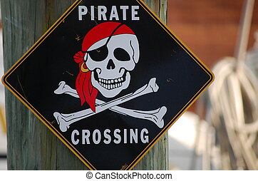 Pirate sign - A black pirate crossing sign posted on a boat...