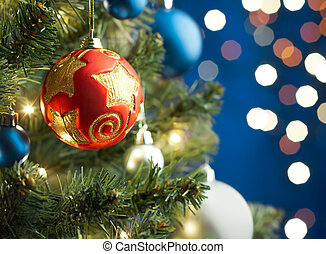 christmas bauble - christmas tree with decoration on blue...