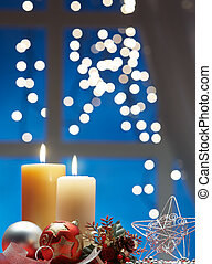 christmas decoration with bauble and candle light