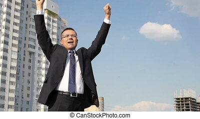Urban success - Successful businessman standing with his...