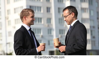Summer coffee-break - Cheerful businessmen having a break...