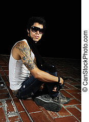 Funky male model - Portrait of young cool male model sitting...