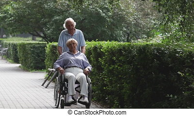 In the park - Senior couple enjoying their walk in the park,...