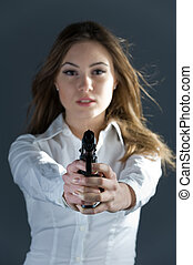 Dangerous and beautiful woman aiming at you - Dangerous and...