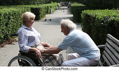 Caring husband - Senior man expressing love taking a good...