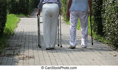 Steps - Elderly couple taking steps together with a help of...